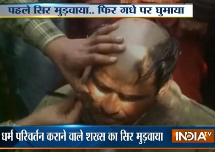 up man tonsured paraded on donkey for converting hindus to- India Tv