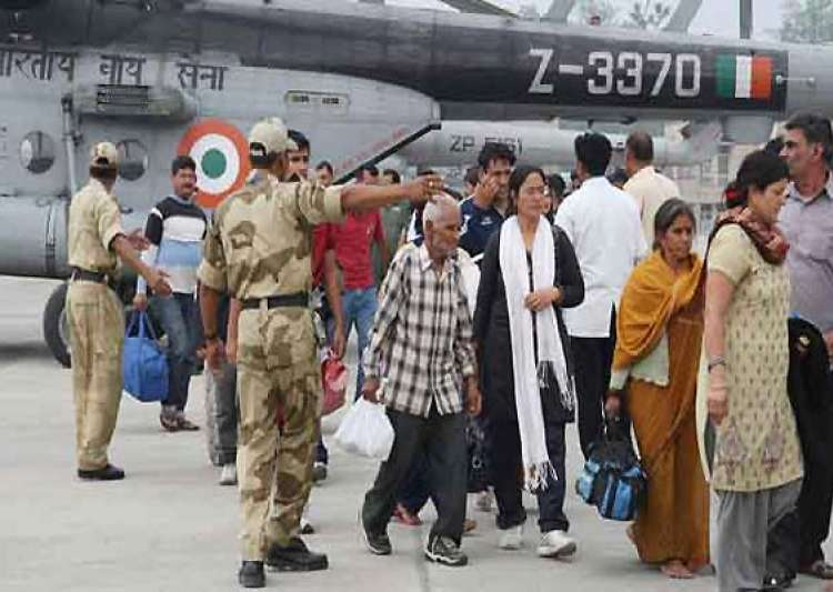 uttarakhand 134 stranded tourists flown to gujarat by- India Tv