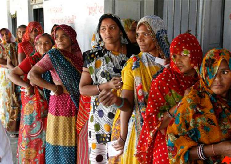 gujarat polls record 67 per cent turnout in modi versus- India Tv