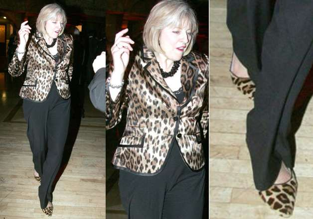 She loves to wear matching shoes with her outfit. In the picture she can bee seen enjoying dancing and flaunting her shiny leopard print blazer with same print shoes.