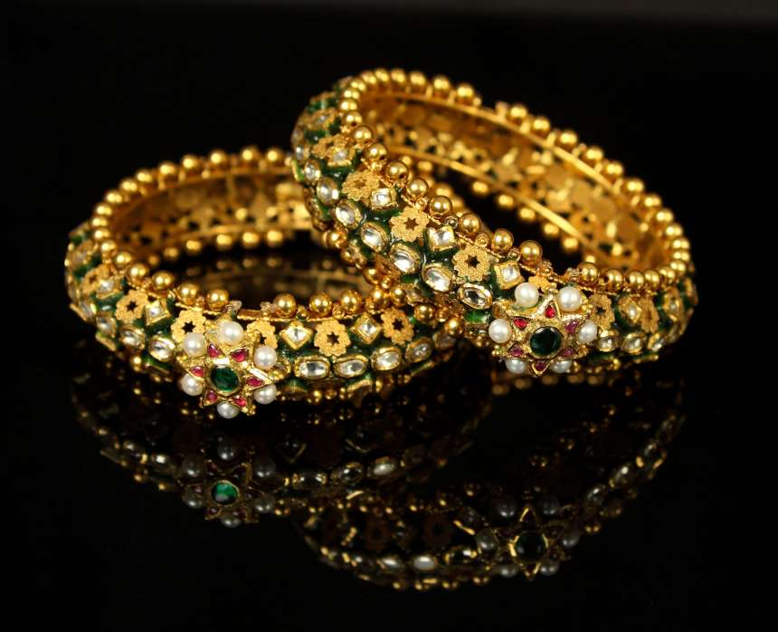 Bangles: Kundan and polka inspired bangles perfectly define elegance and class. Greatly favoured by Indians, bangles are a must for any traditional occasion. Pair these with an ethnic Indian outfit and make heads turn for the right reasons.