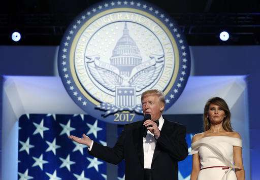 President Donald Trump addresses supporters alongside first lady Melania Trump before dancing at the Liberty Ball