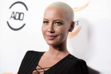 Amber Rose poses topless - India TV