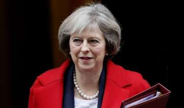 Theresa May wins Brexit timetable vote in...