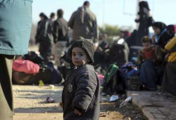 Child at a camp after being evacuated from Aleppo...