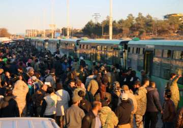 Residents gathered near govt buses for evacuation...