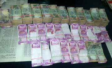 I-T raids post note ban: Rs 33,000 cr in...