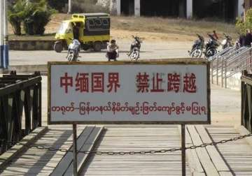 A sign near a bridge linking China with Myanmar ...