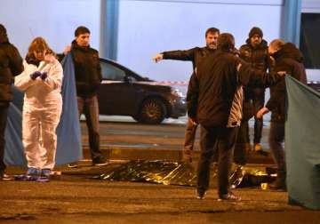 Italian police cordon off an area after killing...