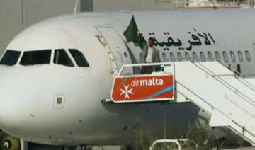 Libyan plane seizing ends peacefully as hijackers...