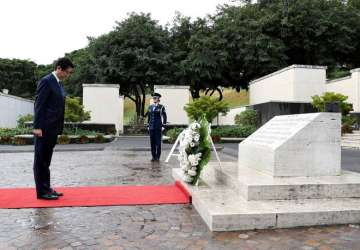 Japan's PM presents a wreath at the National...
