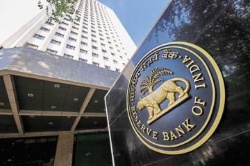 RBI withdraws restriction on deposits - India TV