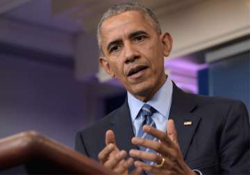 Obama speaks during a news conference on Friday...