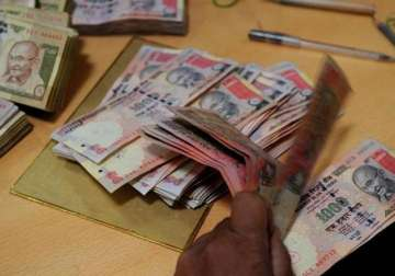 File pic - A bank official counts scrapped Rs...