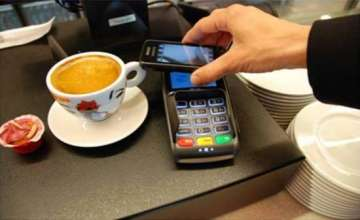 Armed with swipe machine and e-wallet, tea vendor...