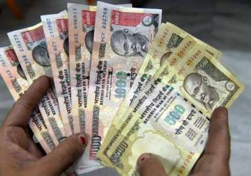 File pic - Old Rs 1,000 and Rs 500 notes on...