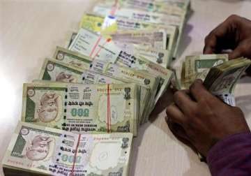 File pic - A bank official counts scrapped Rs 500...
