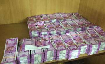 Rs 2.5 crore in new notes recovered from a law...