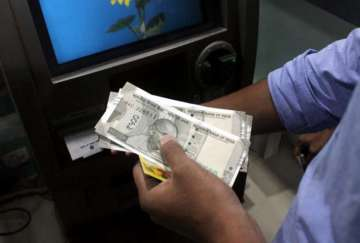 No cap on cash withdrawals at ATMs from Feb 1 -...
