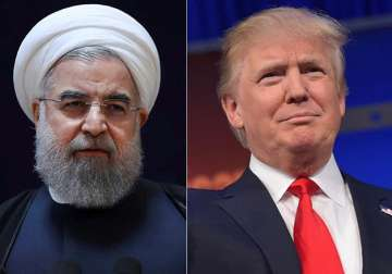 File pic - Hassan Rouhani and Donald Trump -...