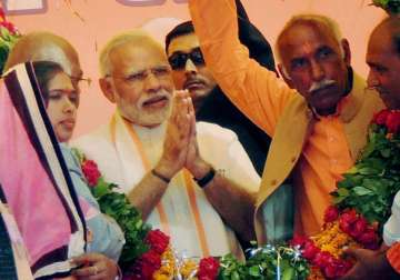 PM Modi being garlanded at an election campaign...