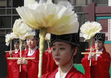 File pic - S Korean students during a ceremony at...
