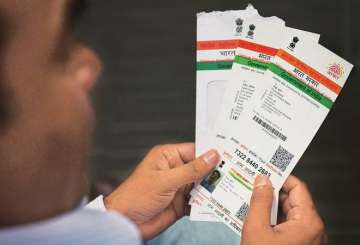 Govt can't make Aadhaar mandatory for access to...