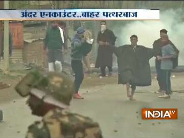Budgam encounter turns ugly as youths pelt stones...