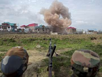 Budgam Smoke blowing out after forces blasted a...