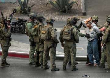 Gunman surrenders after shooting that killed one...