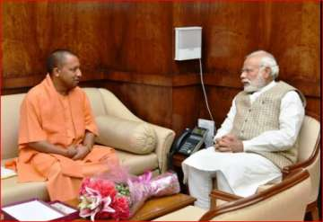 Yogi Adityanath with PM Modi