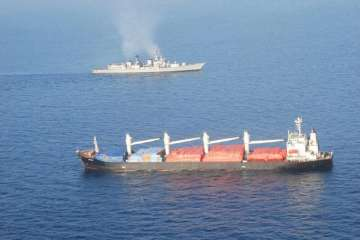 INS Mumbai with the MV OS 35 that was attacked by...
