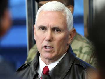 Mike Pence speaks to the media at border village...