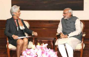 File photo of IMF chief Christine Lagarde with...