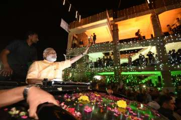 PM Modi reaches Surat, welcomed with road show -...