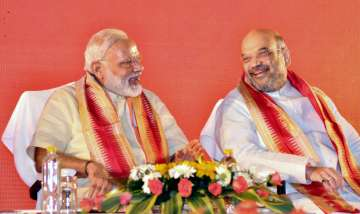 PM Modi withBJP president Amit Shah at National...