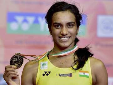 Sindhu poses with her medal after winning final...