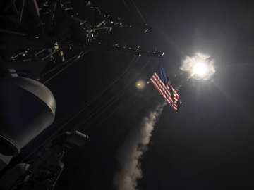 US blasted a Syrian air base with a barrage of...