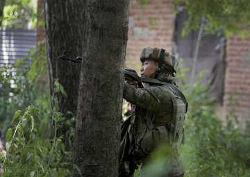 Jawan takes position in a near by house during an...