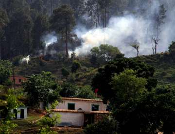 Smoke after a mortar shell was fired by Pakistan...
