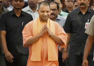 CM Aditiyanath walks to attend the UP Assembly...