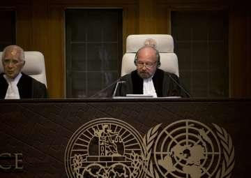 Presiding judge Ronny Abraham of France reads the...