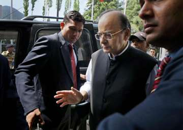 Jaitley arrives to attend the 14th Goods and...