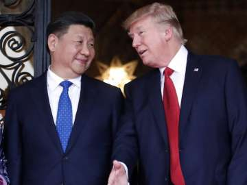 File pic- Chinese President Xi Jinping and US...