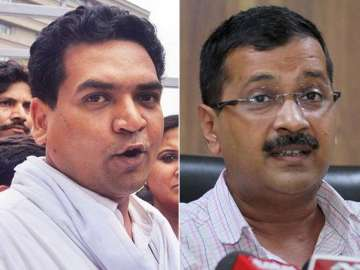 File pic of Kapil Mishra and Arvind Kejriwal -...