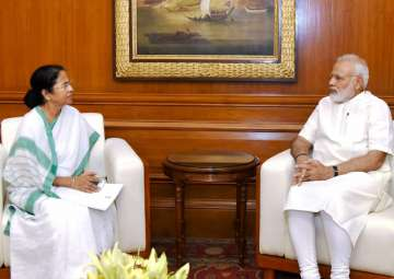 PM Modi with WB CM Mamata Banerjee in New Delhi...