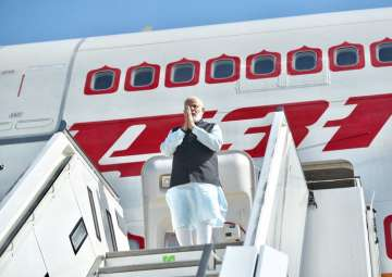 PM Modi arrives in Germany on first leg of his...