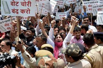 AAP workers protest outside EC officer over...