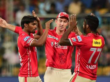 Punjab players celebrate after taking wicket of...