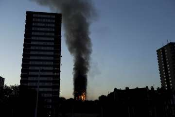 At least 6 dead as massive fire engulfs London's...